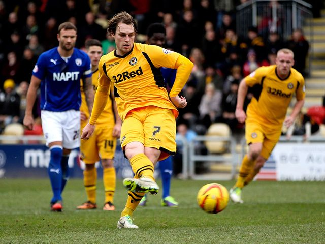 Adam Chapman scores from the penalty spot for Newport.