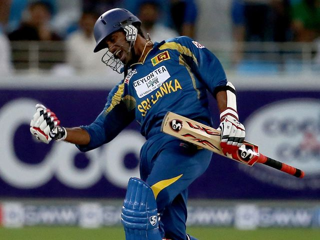 Sachithra Senanayake celebrates hitting the winning runs