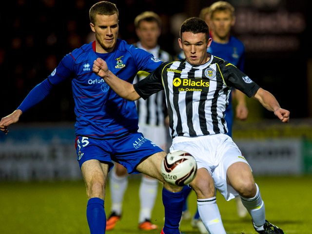 St Mirren's John McGinn shields the ball from Marley Watkins
