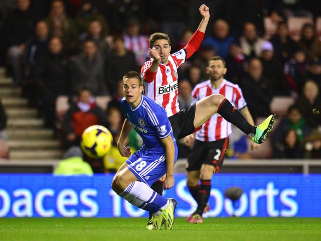 Cesar Azpilicueta tries to block a shot from Fabio Borini