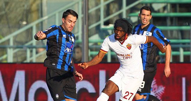 Gervinho is put under pressure by Luca Cigarini