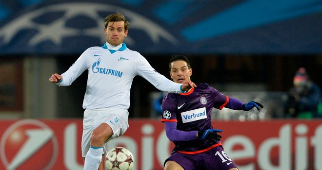 Nicolas Lombaerts: Knocks the ball away from Philipp Hosiner
