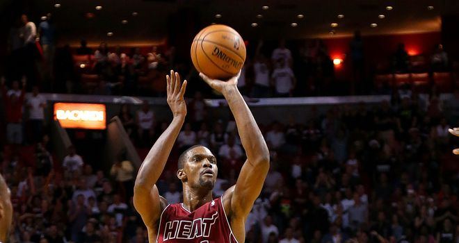 Chris Bosh scored a season-best 37 points as the Miami Heat edged the Portland Trail Blazers