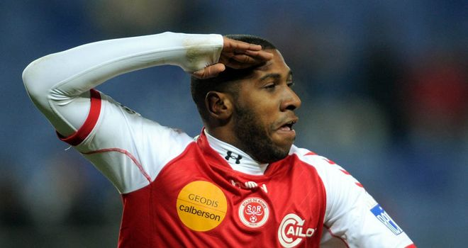 Christopher Glombard celebrates his goal for Reims