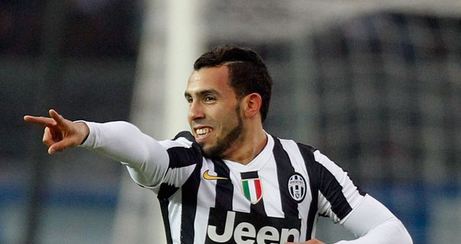 Carlos Tevez celebrates scoring for Juventus
