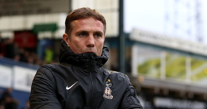 Phil Parkinson: Adds competition in defence