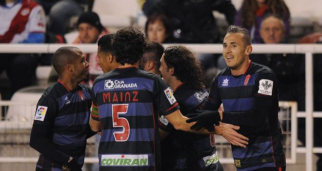 Granada players celebrate after scoring