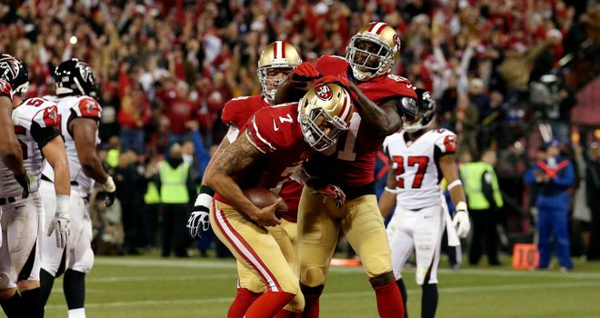 Colin Kaepernick and Anquan Boldin celebrate a touchdown