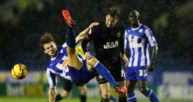 Glenn Loovens: Battles for the ball with Nick Powell of Wigan