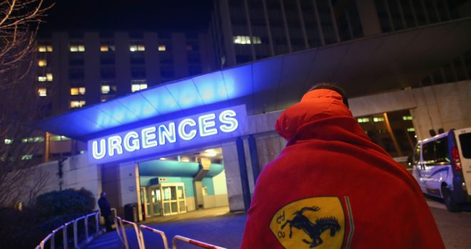 A Ferrari fan outside the medical centre in Grenoble where Schumacher is being treated