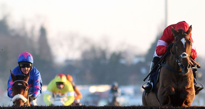 Silviniaco Conti has the measure of Cue Card jumping the final fence in the King George
