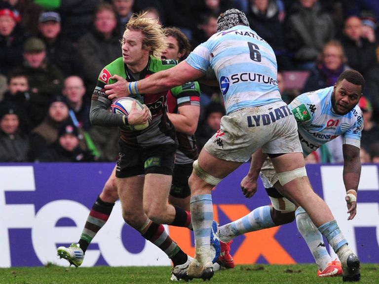 Charlie Walker bursts through for a Harlequins try