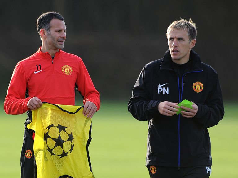 Ryan Giggs and Phil Neville at a Man United training session