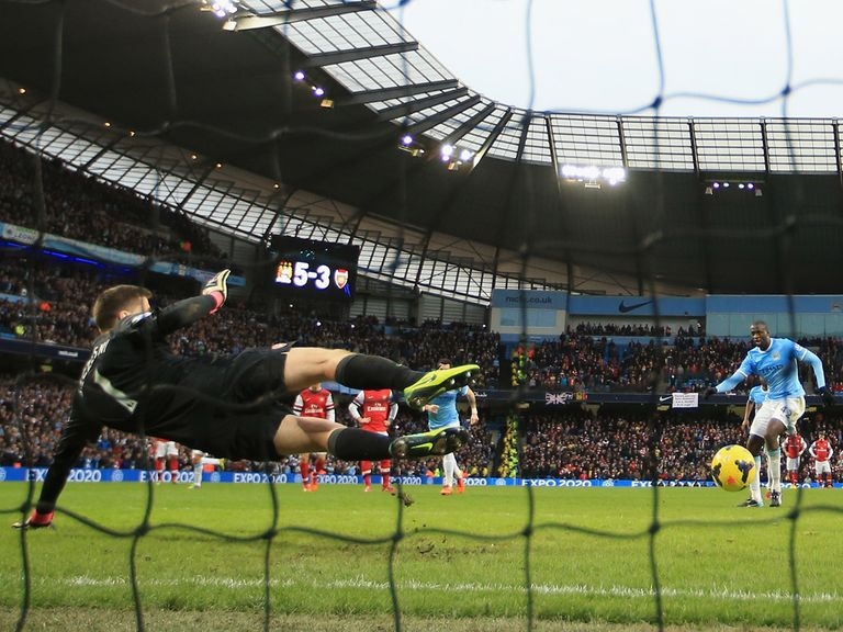 Yaya Toure scores Man City's sixth goal against Arsenal from the penalty spot.