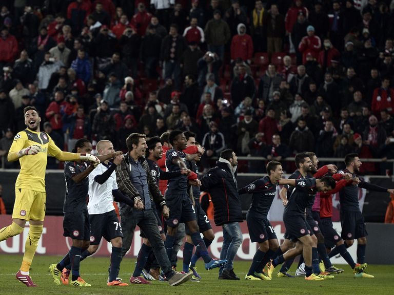 Olympiakos players celebrate