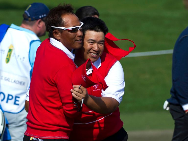 Thongchai Jaidee and Kiradech Aphibarnrat celebrate their win