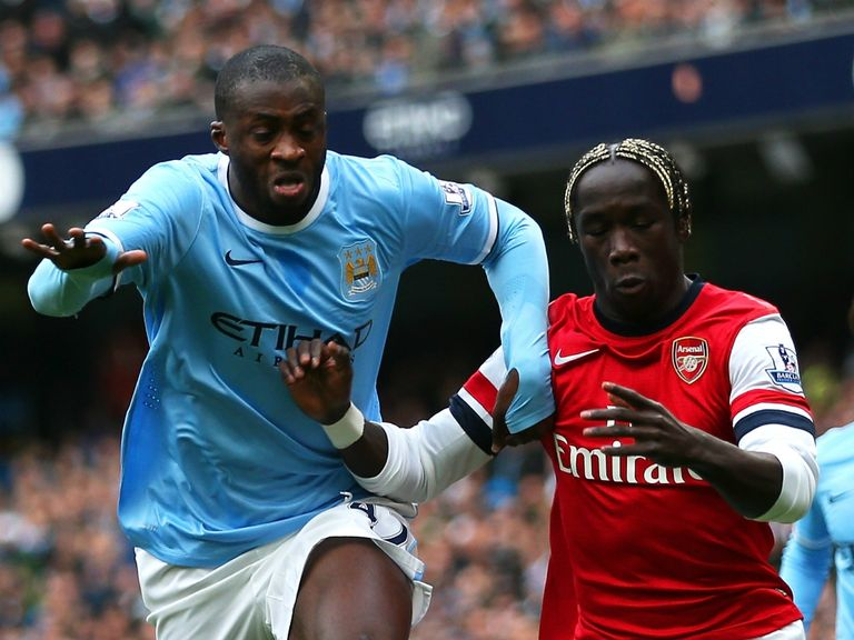 Yaya Toure wins the battle with Bacary Sagna as City win the game