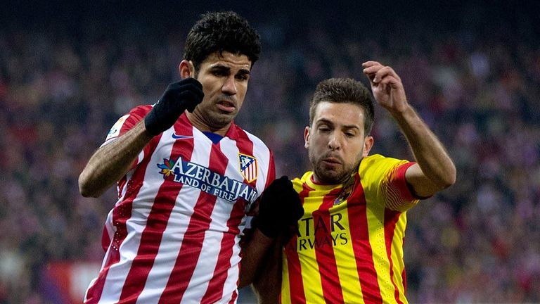 Diego Costa competes for the ball with Jordi Alba