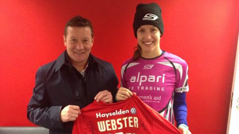 Barnsley boss Danny Wilson hands over a signed shirt to be auctioned for the cause