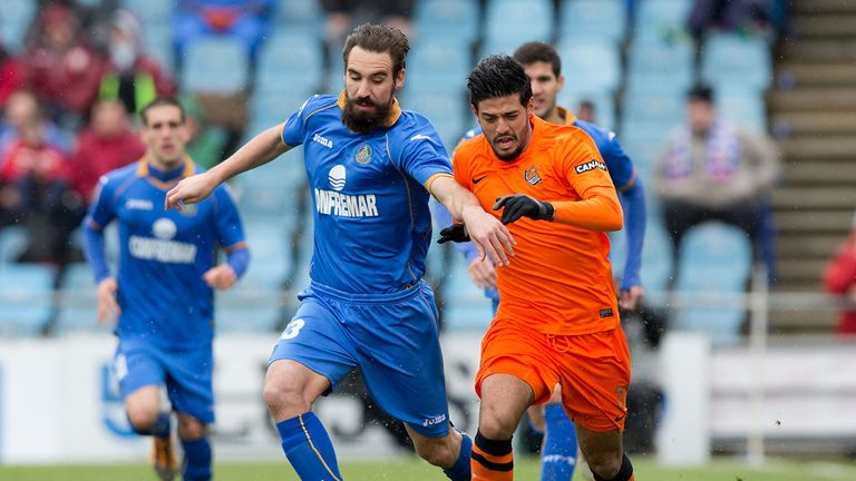 Borja and Carlos Vela battle for the ball