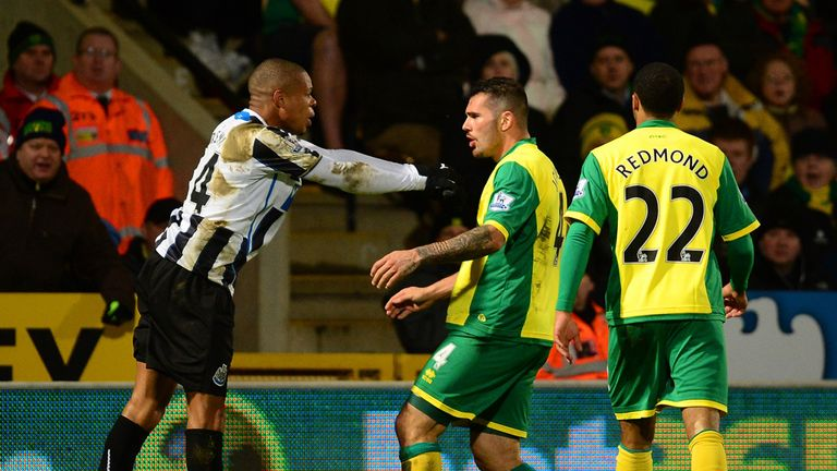 Loic Remy and Bradley Johnson square up