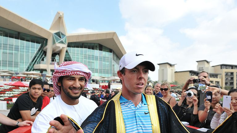 Rory McIlroy is presented with a traditional Emirati Bisht