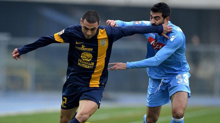Verona's Romulo Souza Orestes vies with Napoli's Raul Albiol