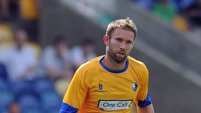 John McCombe: Defender has left Mansfield to join York