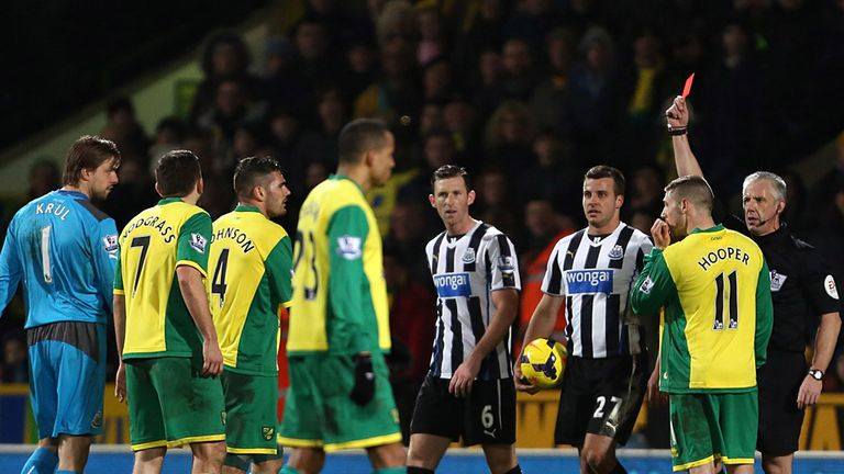 Norwich City's Bradley Johnson (third from left) is shown a red card by referee Chris Foy