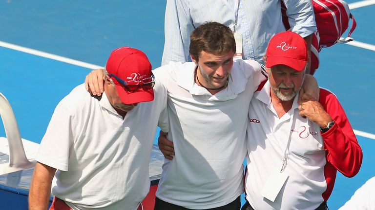 Gilles Simon: Helped from the court after damaging his ankle