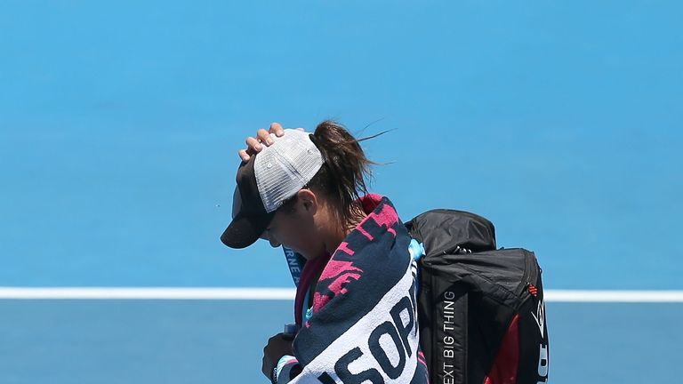 Heather Watson walks off after losing against Daniela Hantuchova