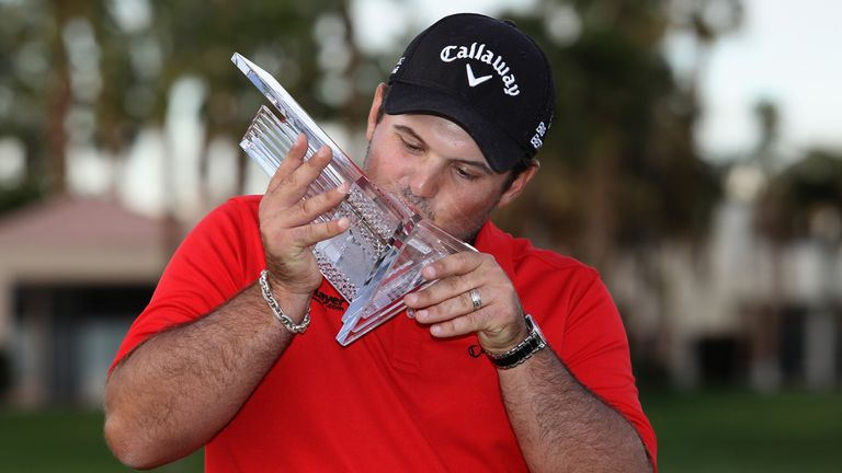 Patrick Reed kisses his trophy after winning the Humana Challenge