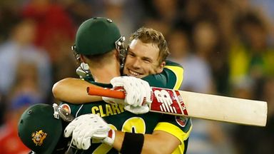 Aaron Finch (right) is congratulated by Michael Clarke on reaching his century at the MCG