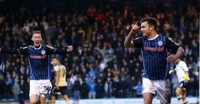 Scott Hogan: Celebrates putting Rochdale on their way to shock win