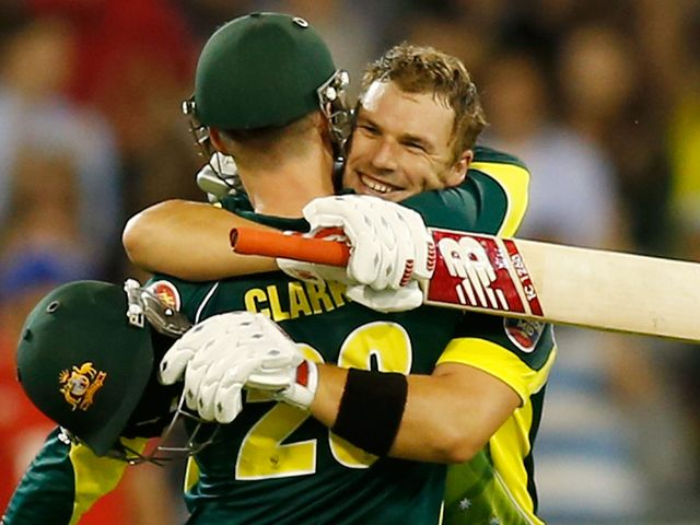 Aaron Finch celebrates his century with skipper Michael Clarke