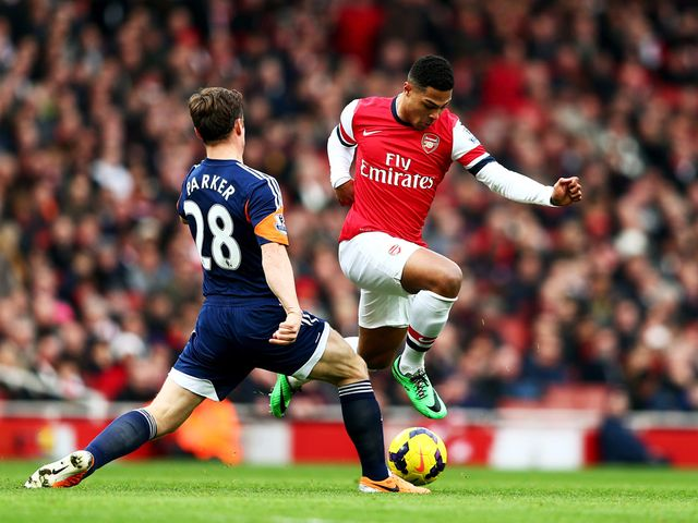 Serge Gnabry is tackled Scott Parker
