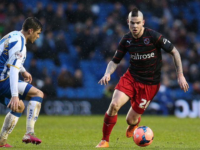 Danny Guthrie of Reading runs at the Brighton defence