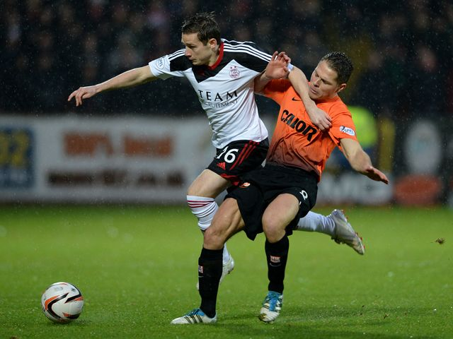 Peter Pawlett gets the better of John Rankin