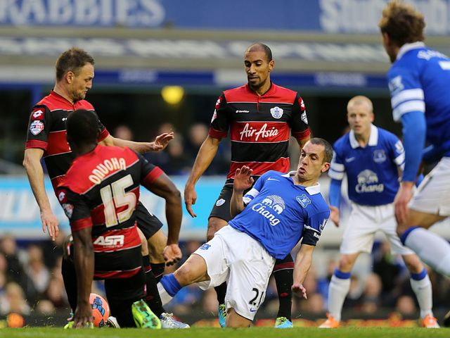 Leon Osman and Nedum Onuoha battle for the ball