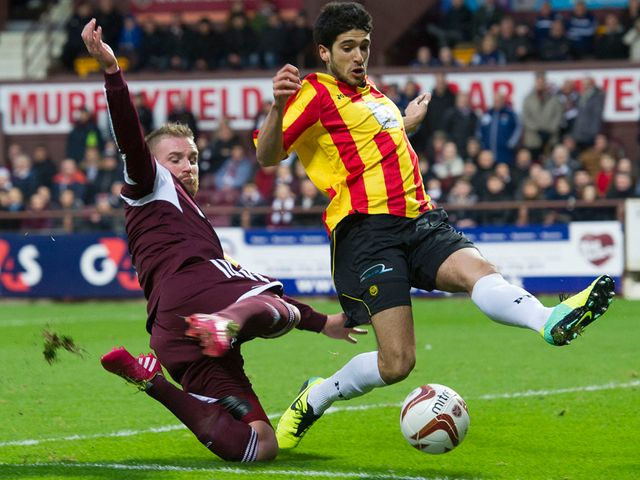 Gabriel Piccolo puts pressure on Hearts' Ryan Stevenson
