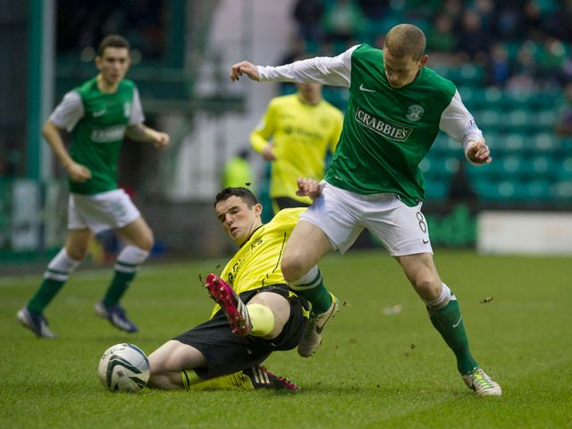 John McGinn slides in on Scott Robertson