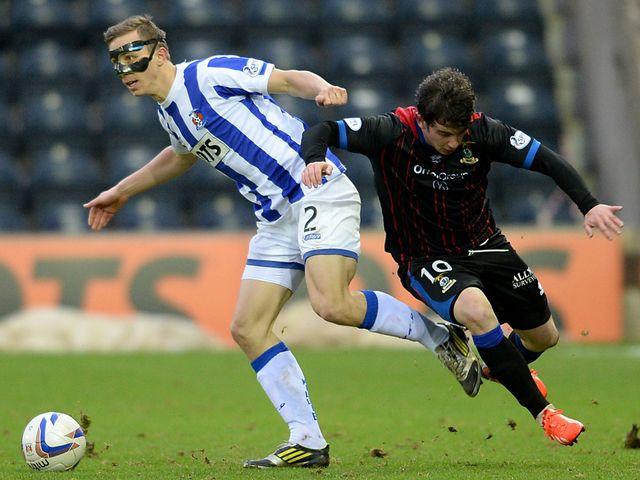 Jeroen Tesselaar skips away from Aaron Doran