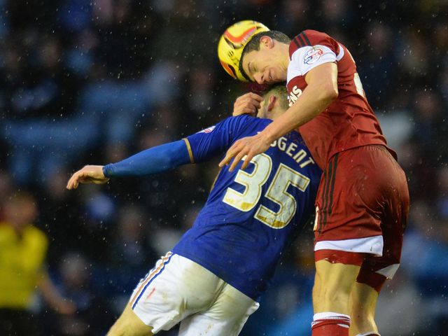 Daniel Ayala beats David Nugent to a header