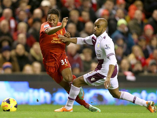 Raheem Sterling tries to avoid Fabian Delph