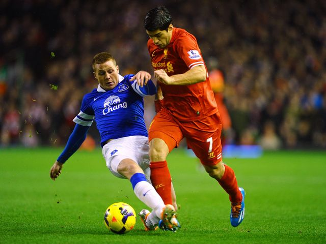Luis Suarez skips past a challenge from James McCarthy