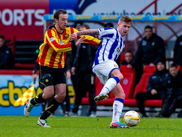 Stuart Bannigan chases down Craig Slater
