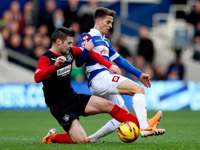 Oliver Norwood tackles Tom Carroll