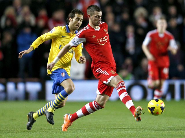 Mathieu Flamini challenges Morgan Schneiderlin