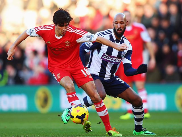 Jack Cork of Southampton holds off Nicolas Anelka