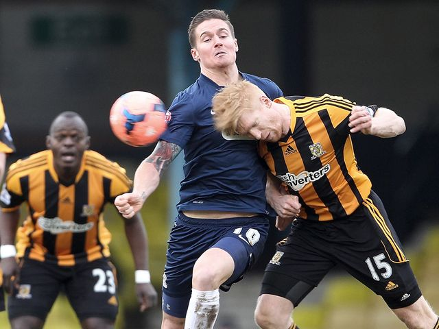 Paul McShane wins a header for Hull